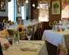 Croissants pet friendly bakery and bistro's dining room with sun flowers on the table and white table cloths