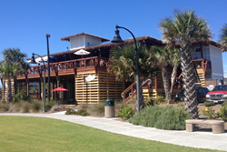 sharkeys beach bar exterior of restaurant with grass lawn and landscaping
